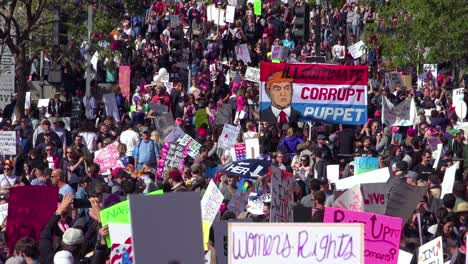 A-huge-protest-against-the-presidency-of-Donald-Trump-in-downtown-Los-Angeles-identifies-the-President-as-a-corrupt-illegitimate-puppet