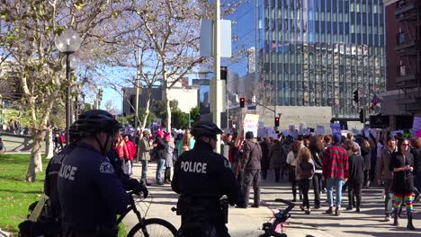 Police-keep-a-close-eye-on-marching-protestors-at-a-rally-against-Donald-Trump-in-downtown-Los-Angeles
