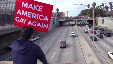 Protestors-against-Donald-Trump-stand-on-an-overpass-in-Los-Angeles-urging-people-to-make-America-gay-again