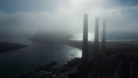 Amazing-aerial-over-large-power-plant-smokestacks-in-the-fog-near-Morro-Bay-California-2