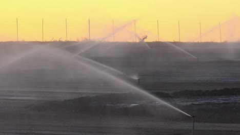 Sprinklers-water-a-dry-field-in-California-during-a-drought-1