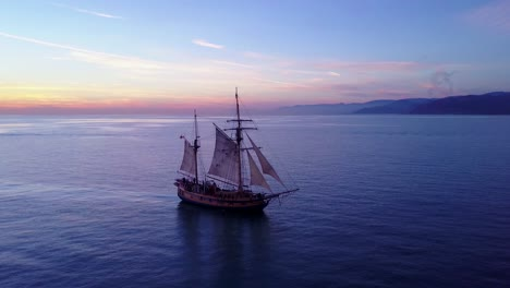 Spectacular-aerial-of-a-tall-sailing-ship-on-the-open-ocean