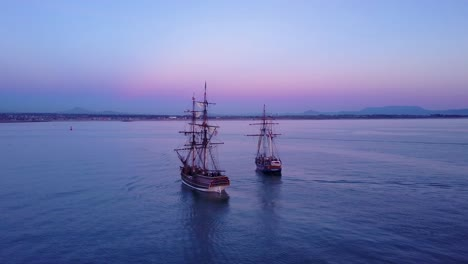 Spectacular-aerial-of-two-tall-sailing-ships-on-the-open-ocean