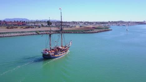 An-aerial-follows-a-tall-ship-entering-Ventura-harbor-California-1