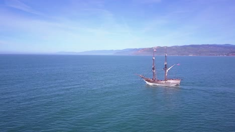 Spectacular-aerial-following-a-tall-sailing-ship-on-the-open-ocean-by-day-4