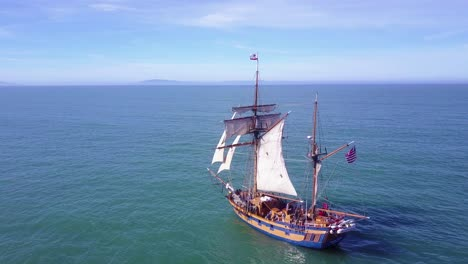 Spectacular-aerial-following-a-tall-sailing-ship-on-the-open-ocean-by-day-9