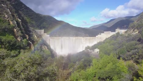 Beautiful-aerial-shot-over-a-dam-in-full-flood-stage-in-Ojai-California-with-rainbow-1