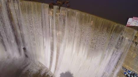 Beautiful-aerial-over-a-high-waterfall-or-dam-in-full-flood-stage-near-Ojai-California-2