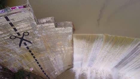 Beautiful-aerial-over-a-high-waterfall-or-dam-in-full-flood-stage-near-Ojai-California-5