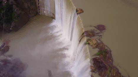 Beautiful-aerial-over-a-high-waterfall-or-dam-in-full-flood-stage-near-Ojai-California-6