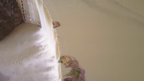 Beautiful-aerial-over-a-high-waterfall-or-dam-in-full-flood-stage-near-Ojai-California-8