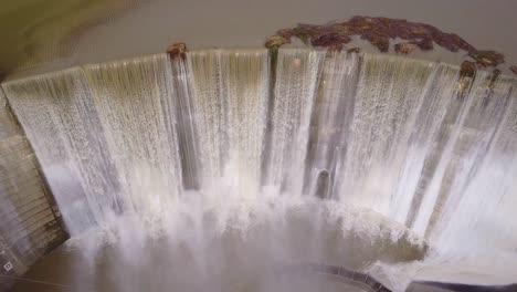 Beautiful-aerial-over-a-high-waterfall-or-dam-in-full-flood-stage-near-Ojai-California-9