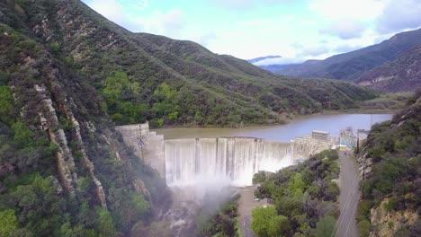 Beautiful-aerial-over-a-high-waterfall-or-dam-in-full-flood-stage-near-Ojai-California-11