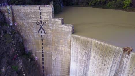 Beautiful-aerial-over-a-high-waterfall-or-dam-in-full-flood-stage-near-Ojai-California-13