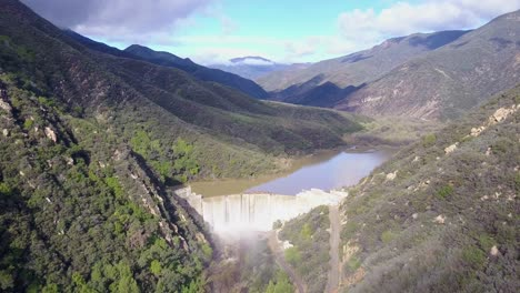 Beautiful-aerial-over-a-high-waterfall-or-dam-in-full-flood-stage-near-Ojai-California-14