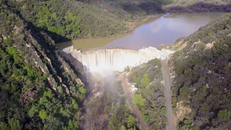 Beautiful-aerial-over-a-high-waterfall-or-dam-in-full-flood-stage-near-Ojai-California-15