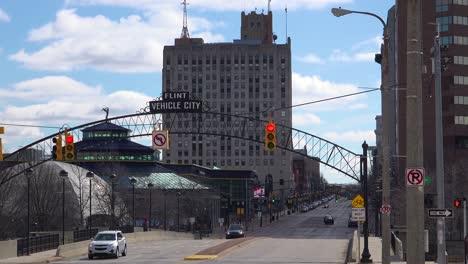 Establishing-shot-of-Flint-Michigan-main-street-and-arch-saying-Vehicle-City-1
