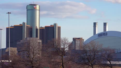 Establishing-shot-of-Detroit-Michigan-with-GM-tower-and-Ford-Field