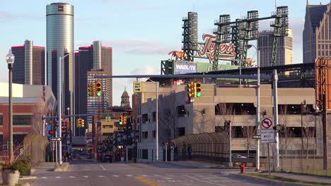 Establishing-shot-of-downtown-Detroit-Michigan-with-GM-tower-and-Ford-Field