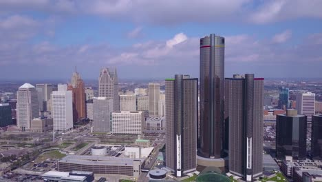 Aerial-shot-of-downtown-Detroit-with-GM-tower-and-Detroit-River-3