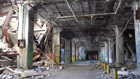 Interior-of-an-abandoned-and-collapsing-automobile-manufacturing-factory-in-Detroit-Michigan