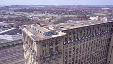 Sweeping-aerial-of-the-exterior-of-the-abandoned-central-train-station-in-Detroit-Michigan