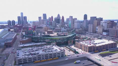 Aerial-shot-over-the-city-of-Detroit-with-Ford-Field-and-the-GM-tower-in-the-background