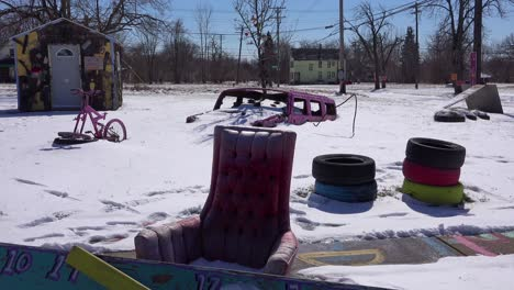 Abandoned-items-in-the-snow-in-a-ghetto-section-of-downtown-Detroit-Michigan