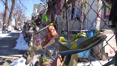 Shoes-hang-on-a-fence-in-a-ghetto-section-of-downtown-Detroit-Michigan-1