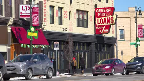A-sign-along-a-busy-street-indicates-payday-loans-are-available