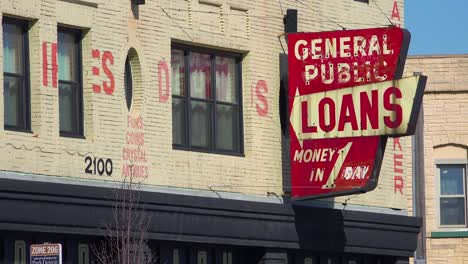 A-sign-along-a-busy-street-indicates-payday-loans-are-available-1