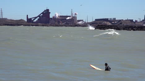 Surfers-brave-a-highly-polluted-industrial-area-on-Lake-Michigan