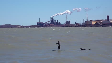 Surfers-brave-a-highly-polluted-industrial-area-on-Lake-Michigan-near-Gary-Indiana