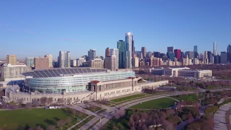 An-aerial-over-Chicago-s-Soldier-Field-and-skyline-1