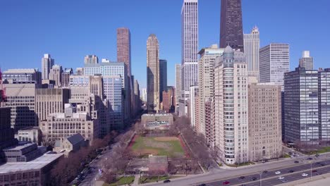 Rising-aerial-along-lakeshore-Drive-reveals-downtown-Chicago-skyline