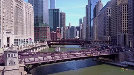 An-aerial-over-the-Chicago-River-and-riverboats-in-downtown-Chicago