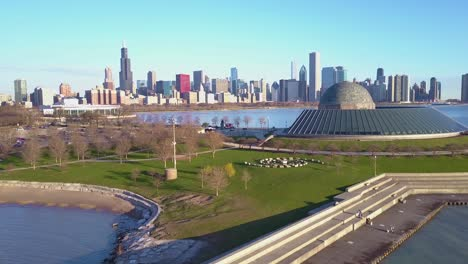 An-aerial-of-the-Adler-Planetarium-with-the-Chicago-skyline-in-the-background