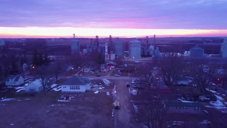Aerial-at-sunset-near-a-small-midwestern-town