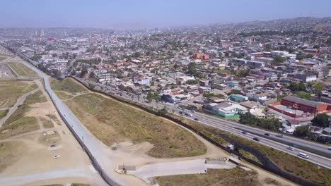 High-aerial-over-the-border-wall-fence-separating-the-US-from-Mexico-and-San-Diego-from-Tijuana