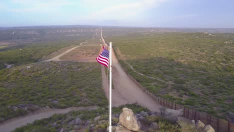 The-American-flag-flies-over-the-US-Mexico-border-wall-in-the-California-desert-5