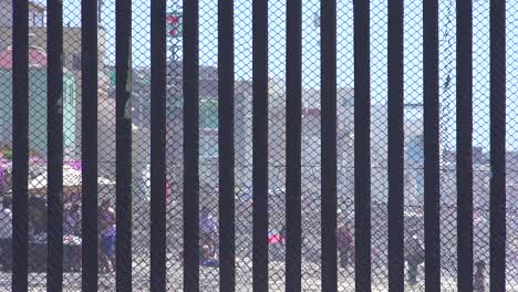 Mexican-visit-the-beach-at-the-US-Mexico-border-fence-in-the-Pacific-Ocean-between-San-Diego-and-Tijuana-2