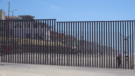 Mexican-visit-the-beach-at-the-US-Mexico-border-fence-in-the-Pacific-Ocean-between-San-Diego-and-Tijuana-3