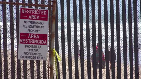 Signs-warn-of-a-restricted-area-at-the-US-Mexico-border-fence-in-the-Pacific-Ocean-between-San-Diego-and-Tijuana-1