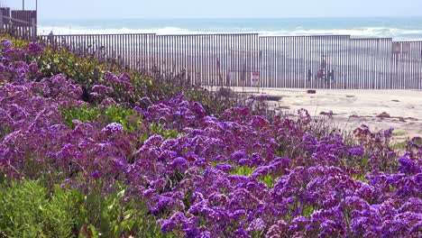 Waves-roll-into-the-beach-at-the-US-Mexico-border-fence-in-the-Pacific-Ocean-between-San-Diego-and-Tijuana-4