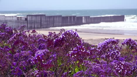 Waves-roll-into-the-beach-at-the-US-Mexico-border-fence-in-the-Pacific-Ocean-between-San-Diego-and-Tijuana-5