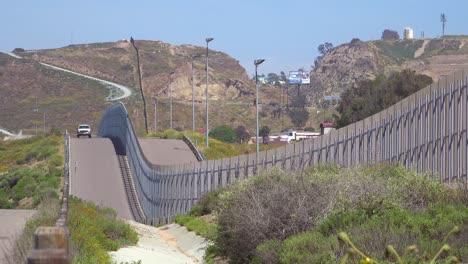 A-border-patrol-vehicle-moves-along-the-border-wall-between-San-Diego-and-Tijuana