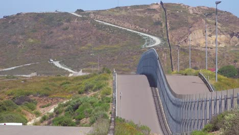 A-border-patrol-vehicle-moves-along-the-border-wall-between-San-Diego-and-Tijuana-3