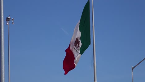 The-Mexican-flag-flies-along-the-US-border-in-Tijuana