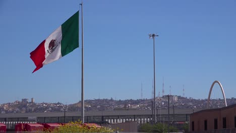 The-Mexican-flag-flies-along-the-US-border-in-Tijuana-1
