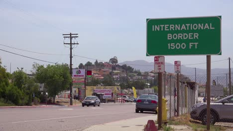 A-sign-announces-the-International-Border-between-the-US-and-Mexico